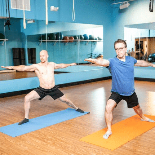 Men on a warrior pose